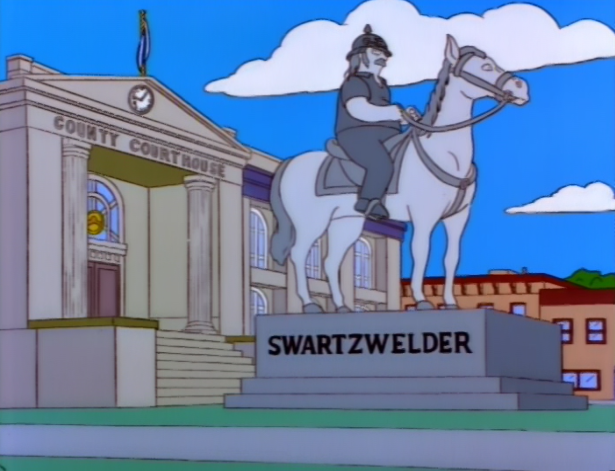 An image of a statue of John Swartzwelder in The Simpsons.